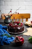 Chocolate band cake with pomergrenate.style vintage. Chockolate band cake with pomergrenate.style vintage.selective focus royalty free stock photography