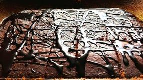 Chockolated cake. Chockolate brownie black and brown fullframe kitchen baking cake deserts backgrounds texture Stock Photo