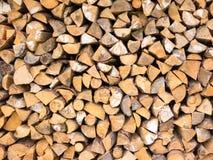 Chocks of firewood in a storage Stock Photo