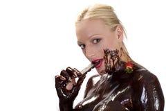 choclate τρώγοντας τη φράουλα Στοκ Εικόνα