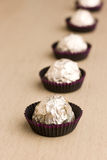 Choco  candies in foil on table Royalty Free Stock Photography