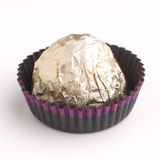 Choco candy in golden foil Stock Photo