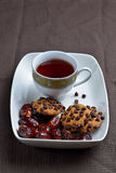 Choco chips cookies, dates and black tea Royalty Free Stock Image