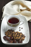 Choco chips cookies, dates and black tea Stock Images