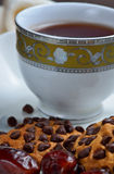 Choco chips cookies, dates and black tea Royalty Free Stock Photos