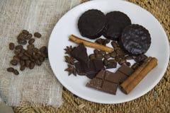 Choco with coffee and cinnamon 30. Choco cookies with chocolate bar, coffee beans and aroma sticks Royalty Free Stock Image