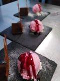 Choco muss with ice cream on Black plates royalty free stock photo