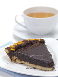 Choco pie and tea. A piece of chocolate pie served with a cup of hot tea stock images