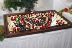 ChocoBerry Heart. Tray of chocolate covered strawberries displayed in a heart shape for a banquet or special occasion Royalty Free Stock Photo