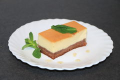 Chocoflan. Cake a mix between creme caramel and chocolate genoa cake with a little mint leaf to freshen up Royalty Free Stock Image