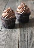 Chocolade Cupcake met vork Stock Foto