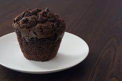 Chocolade Cupcake met vork Stock Afbeelding