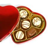 Chocolade in de doos van de hartvorm royalty-vrije stock afbeeldingen
