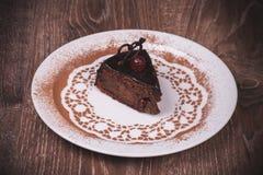 Chocolade en kersencakeplak Royalty-vrije Stock Afbeeldingen