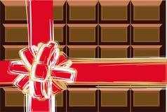 Chocolade en rood lint Stock Afbeeldingen