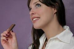 Chocolade en vrouw Stock Foto's