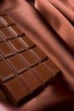 Chocolade en zijde Royalty-vrije Stock Foto