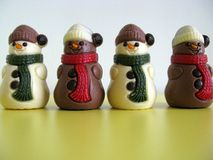 Chocolade figures. White and brown snowmen of chocolade Stock Images