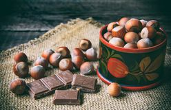 Chocolade and hazel nuts in wooden box Stock Photography