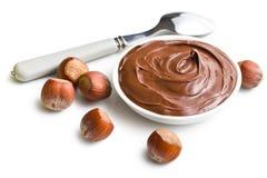Chocolade in kom wordt uitgespreid die stock foto's