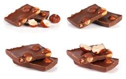 Chocolade met hazelnoten op witte achtergrond Reeks of inzameling royalty-vrije stock afbeelding