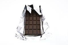 Chocolade op een folie Stock Foto's