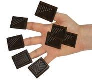 Chocolade op vingertoppen Royalty-vrije Stock Afbeelding