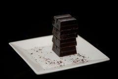 Chocolade op Witte Plaat Stock Afbeeldingen