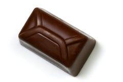 Chocolade over wit stock afbeelding