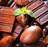 Chocoladeachtergrond Pralinechocolade Stock Afbeeldingen