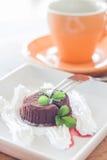 Chocoladelava met koffiekop Stock Afbeelding
