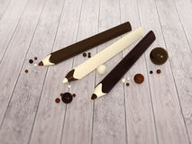Chocoladepotloden en ballen op houten vloer Royalty-vrije Stock Afbeeldingen