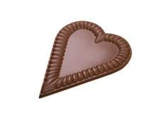 Chocolat au lait délicieux dans la forme du coeur Photo stock