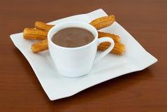 Chocolat avec Churros Images stock
