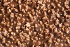 Chocolat avec la texture nuts Photos stock