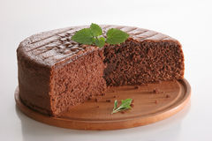 Chocolat cake. Chocolate cake without layers, with mint leaves, on white background Stock Images
