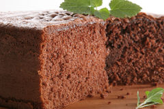 Chocolat cake. Chocolate cake without layers, with mint leaves, on white background Stock Photo