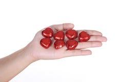 Chocolat de coeur en main Photographie stock
