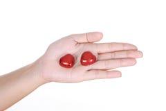 Chocolat de coeur en main Photos libres de droits