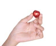 Chocolat de coeur en main Photo stock