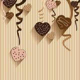 Chocolat de Saint-Valentin et de coeur sur le fond coloré Dirigez le chocolat de partie et le plein coeur sur le fond coloré Image libre de droits