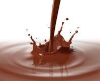 Chocolat de versement images stock