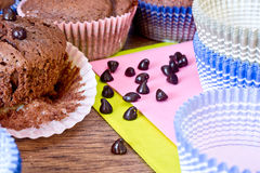 Chocolat drops and chocolat muffins Royalty Free Stock Photo