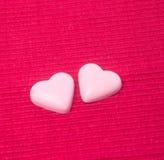 chocolat en chocolat rose de forme de couleur ou d'amour Images libres de droits