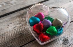 Chocolat en verre en forme de coeur Photos libres de droits
