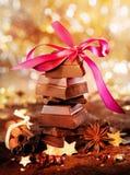 Chocolat et épices de fête Photos stock
