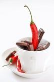 Chocolat et poivre foncés images stock