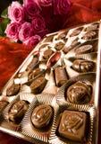 Chocolat et roses Image libre de droits