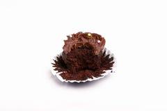 Chocolat fairy cake bitten into on white Royalty Free Stock Photo