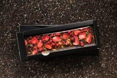 Chocolat fait main avec la graine sèche de fraises, de canneberge et de citrouille Images stock